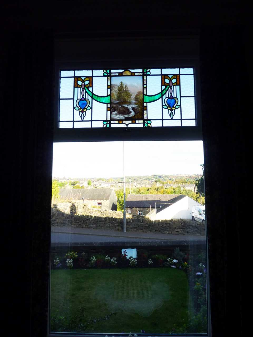 Picture window with stained glass panel