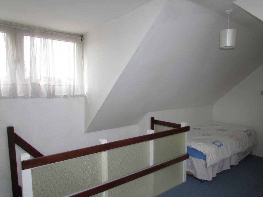 Boarded loft bedroom